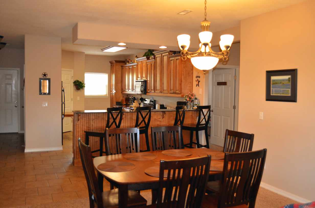 alternate-view-of-dining-table-and-kitchen-with-seating-for-10