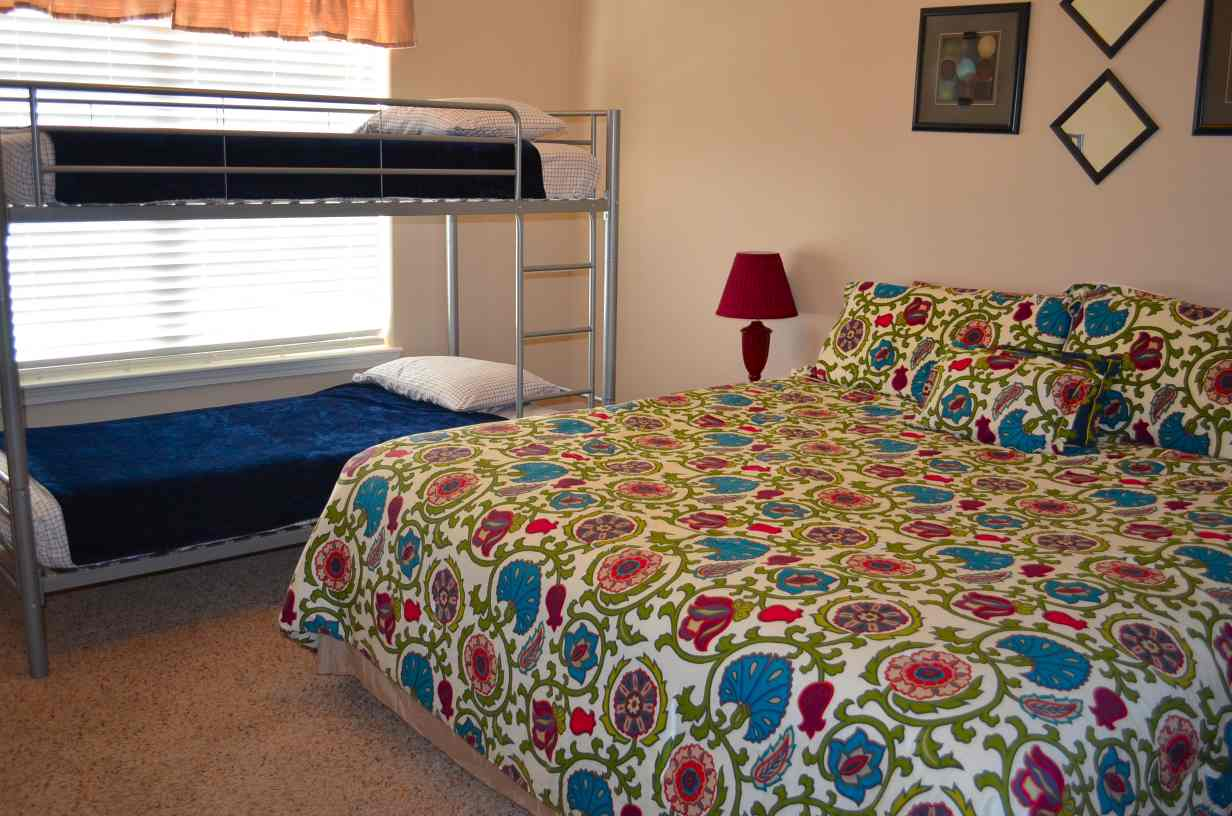 bedroom-number-2-with-bunkbeds-and-a-king-size-bed
