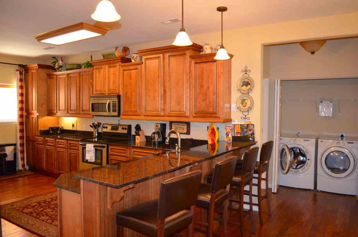 hardwood-floors-front-loading-washer-and-dryer-surround-the-kitchen-of-rockwood-13