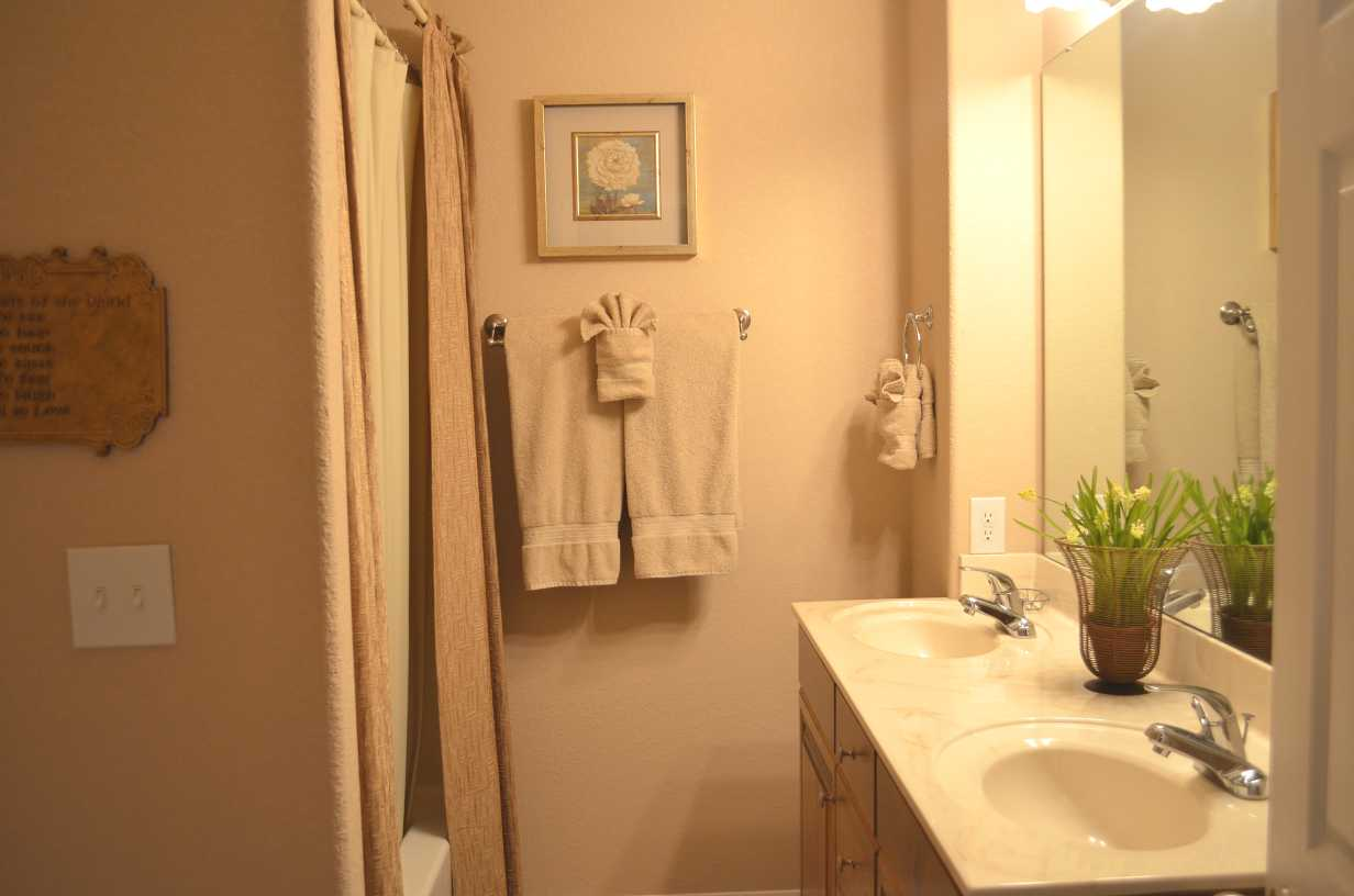 main-bathroom-with-combination-tub-and-shower-with-2-person-sink